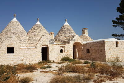 GROUP OF TRULLI AND LAMIE WITH 4 CONES IN MARTINA FRANCA, APULIA