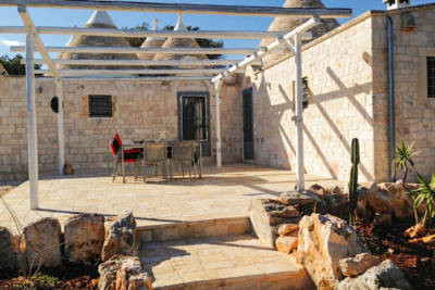 COMPLEX OF TRULLI WITH SIX CONES AND A LAMIA FOR SALE IN OSTUNI, APULIA